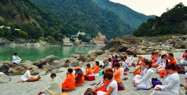 Yoga on banks of river Ganga - Rishikesh - A destination for global traveller - The Backpackers Group - Travel Blog